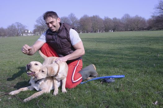 A man and his two dogs in the park
