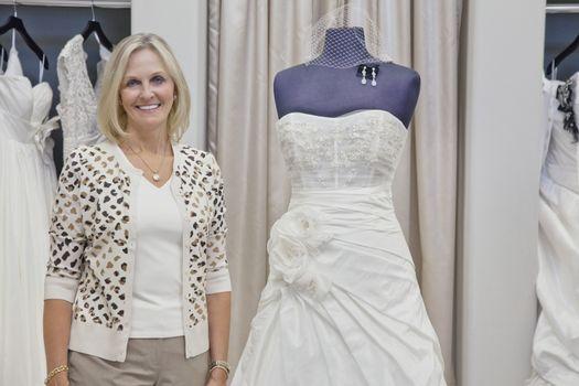 Portrait of a happy senior bridal store owner
