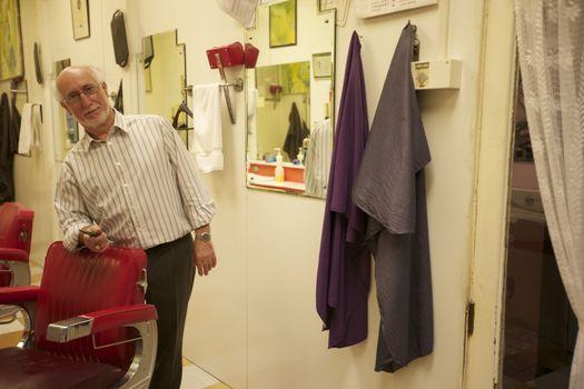 Portrait of senior barber in shop