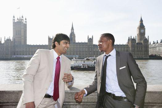 Two multi ethnic businessmen having a conversation