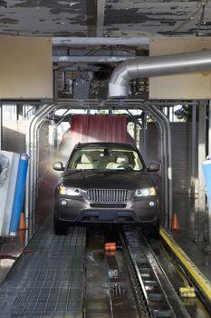 Motor vehicle passing through car wash