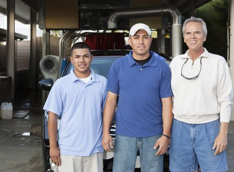 Portrait of owner with employee in car wash