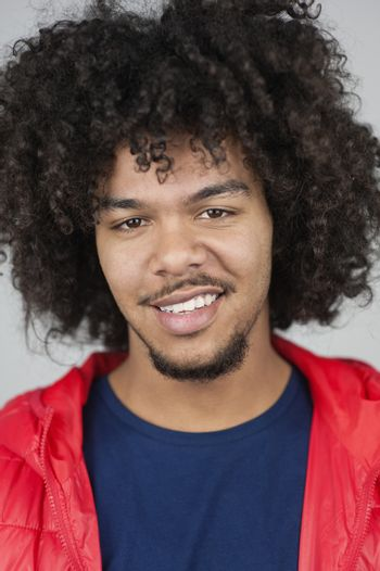 Portrait of happy young man with curly hair