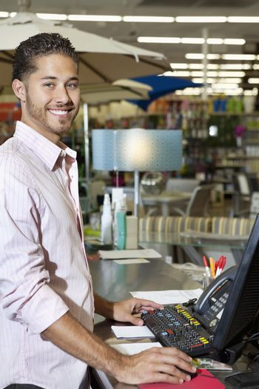 Portrait of a happy store clerk in shop