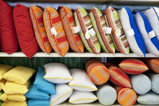 Multicolored cushions on display in store