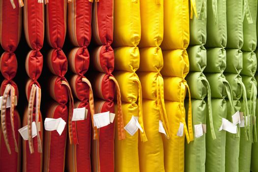 Multicolored cushions arranged in store
