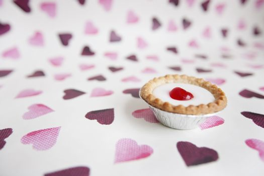 Close-up of cupcake over heart shaped background