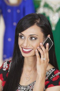 Beautiful Indian woman answering phone call