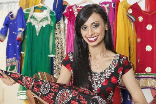 Portrait of Indian dressmaker holding a cloth