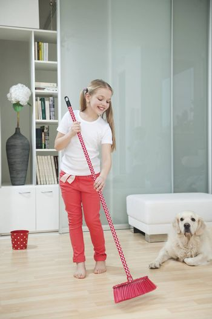 Girl sweeping the floor