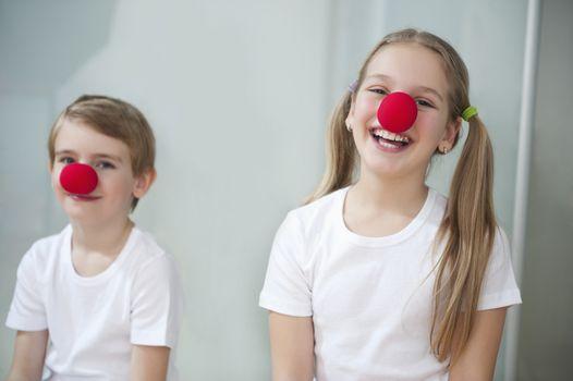 Portrait of children wearing clown noses