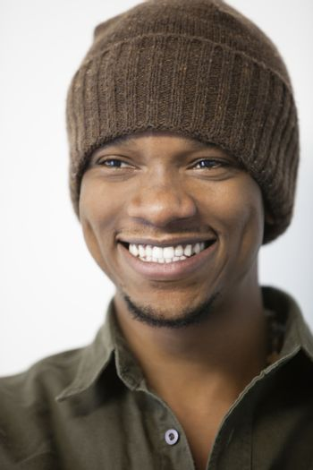 Close-up of a cheerful African American man wearing knit hat