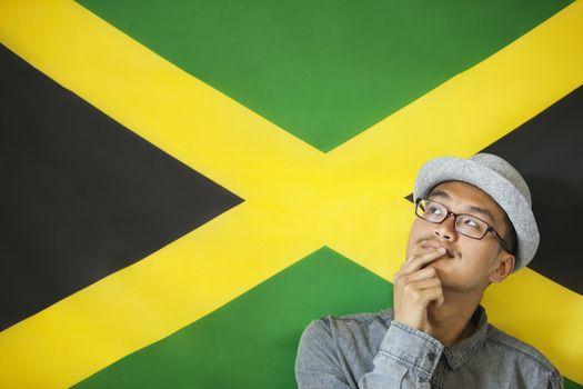 Thoughtful man against Jamaican flag
