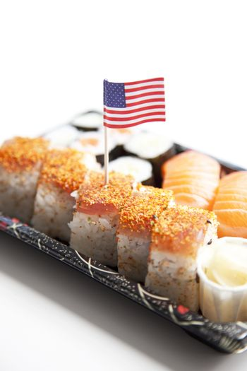 Sushi food on tray with American flag against white background