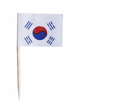 Korean flag in toothpick against white background