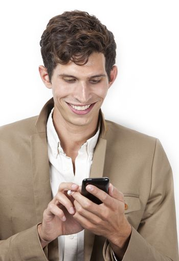 Happy young man text messaging against white background
