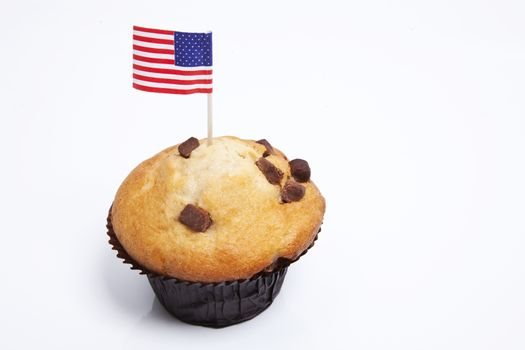 American flag in cupcake on white background