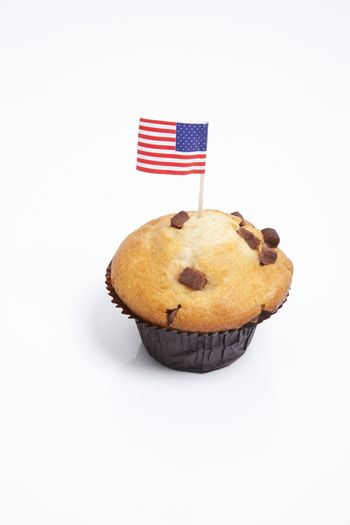 American flag in cupcake over white background