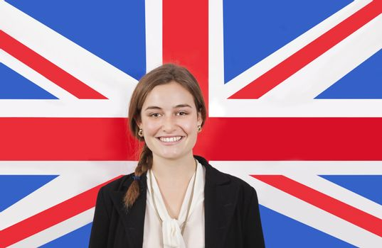 Portrait of young businesswoman smiling over British flag