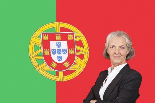 Portrait of senior businesswoman with pride over Portuguese flag