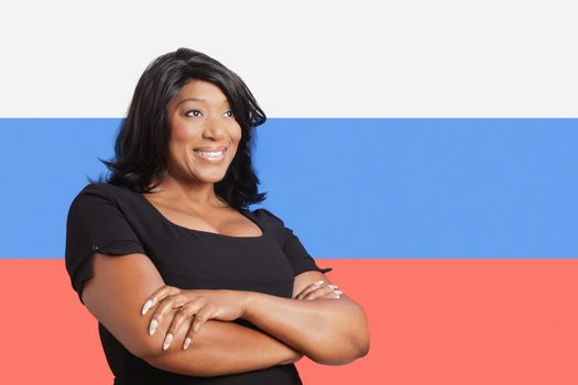 Thoughtful casual mixed race woman over Russian flag
