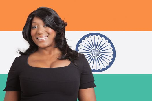 Portrait of casual mixed race woman over Indian flag