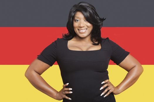 Portrait of casual mixed race woman against German flag