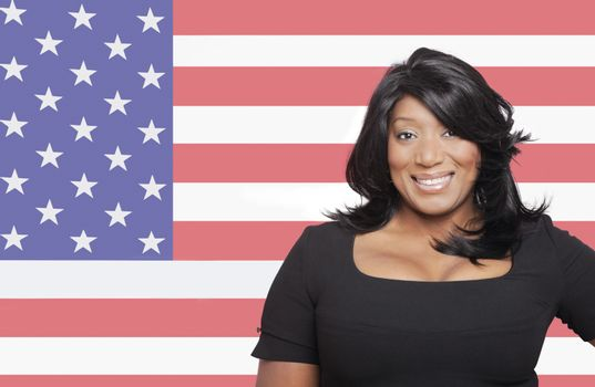 Portrait of casual mixed race woman against American flag