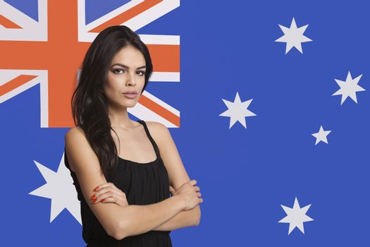 Portrait of young woman against Australian flag