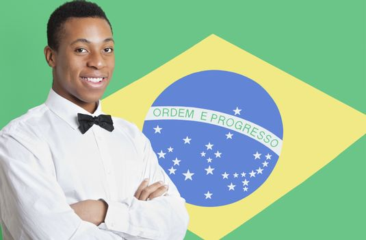 Portrait of mixed race man against Brazilian flag