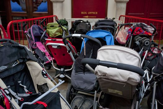 Group of prams outside theatre