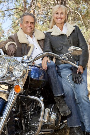 Close up of senior couple with motorcycle