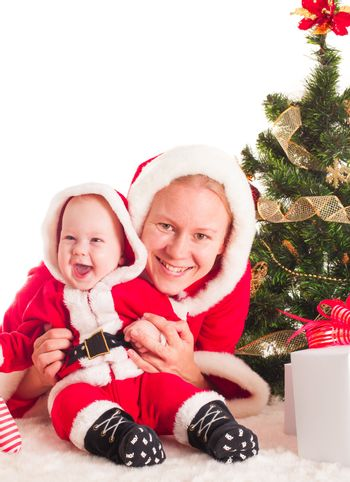 Christmas baby and mom under the fir tree