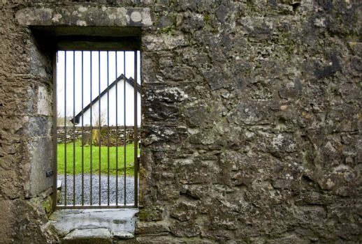 Locked gate in old stone wall