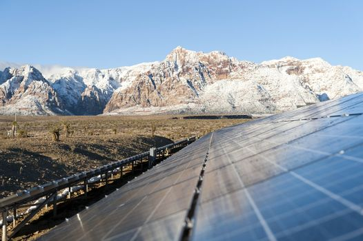 Mountains behind Solar panels