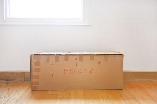 "Cardboard box marked ""fragile"""