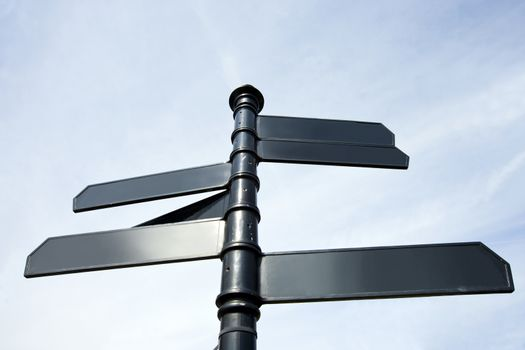Metal signs pointing in all sort of directions in London, UK