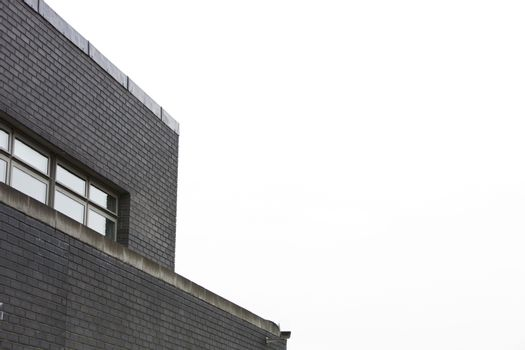 Low angle view of a surveillance camera on the side of a building