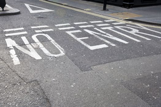 Close-Up of road marking saying No Entry in London, UK