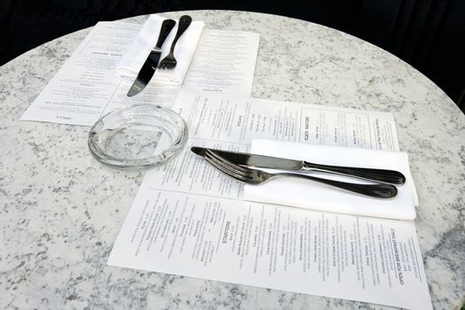 Caf�� table with cutlery and menus