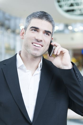 Close-up of businessman on mobile phone