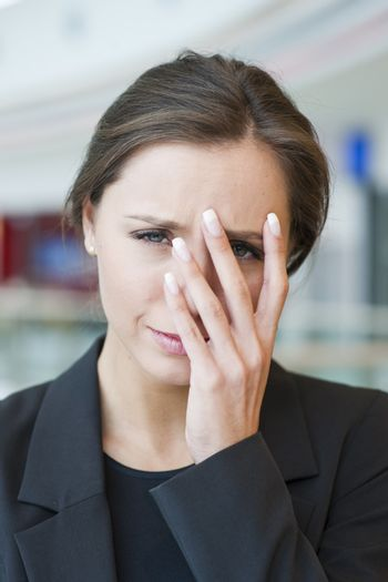 Stressed businesswoman looking at camera
