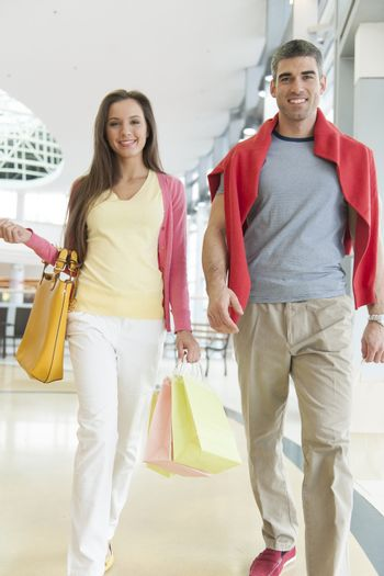Couple with shopping bags in mall