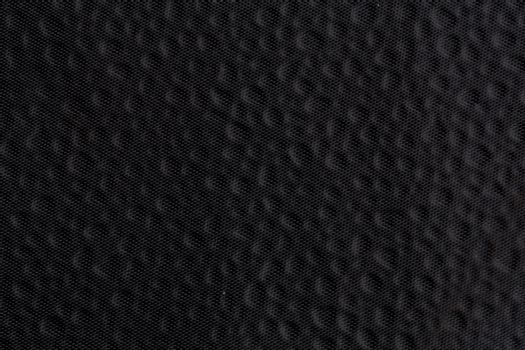 Graphical background, black dotted fabric texture