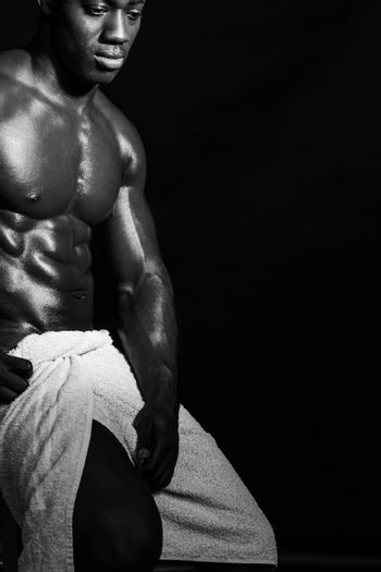 Muscular male model wrapped in a towel