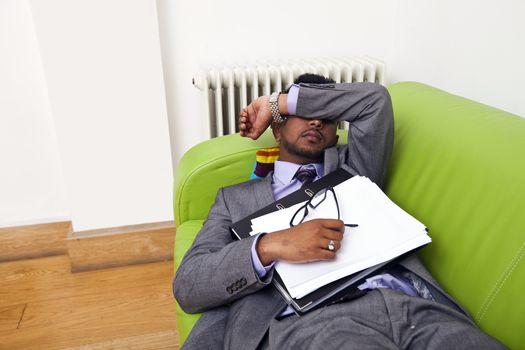 Businessman sleeping on a sofa