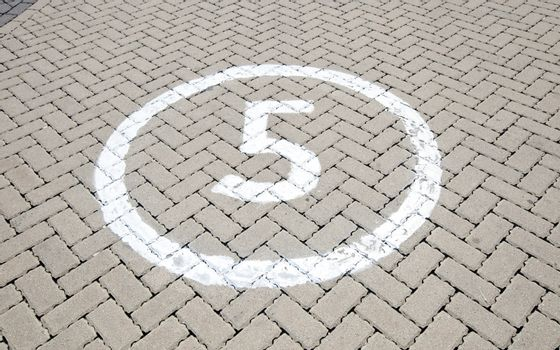 Number '5' on the road