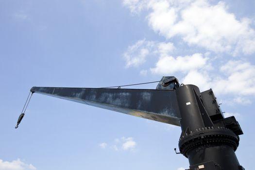 Black construction crane from below