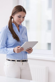 Beautiful businesswoman using tablet computer
