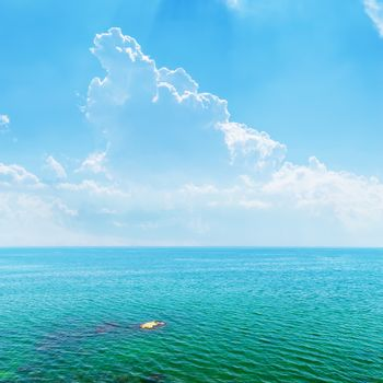 azure sea and blue sky with clouds